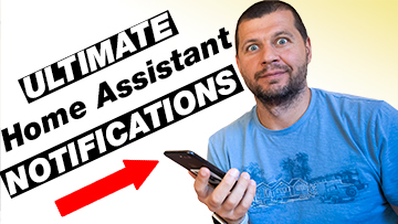 Me holding a phone with ultimate Home Assistant notifications label