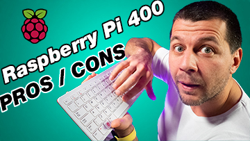Kiril Peyanski holding a raspberry pi 400 with a label raspberry pi 400 pros / cons